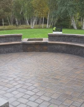 Bow Patio with Built in Benches and Firepit